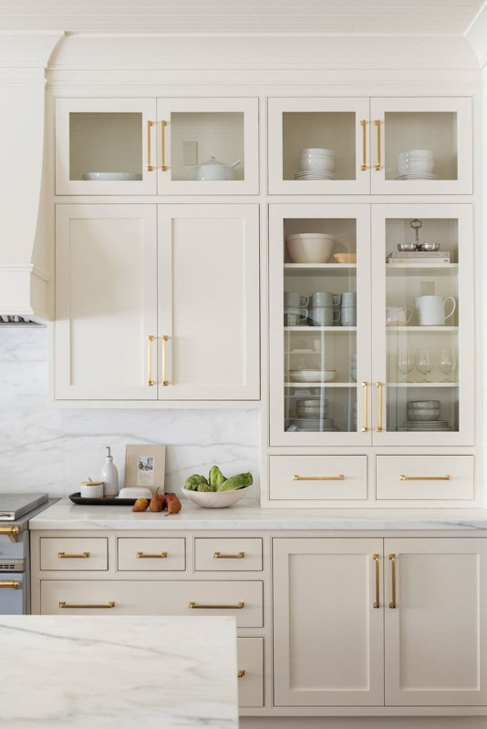 Kitchen cabinetry painted in Swiss Coffee by Benjamin Moore.