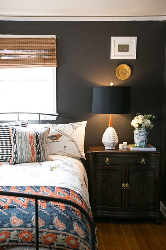 A small bedroom painted in urbane bronze