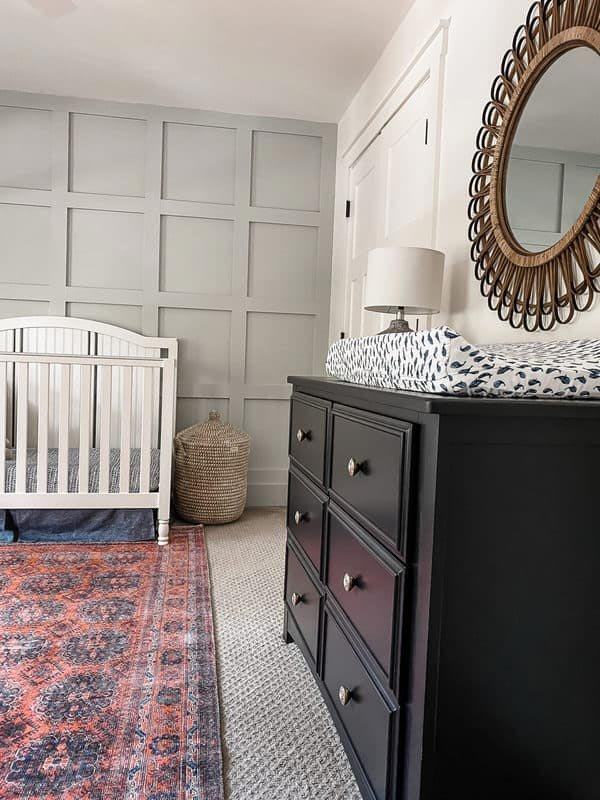 Silver Strand by Sherwin Williams featured on an accent wall of a nursery.