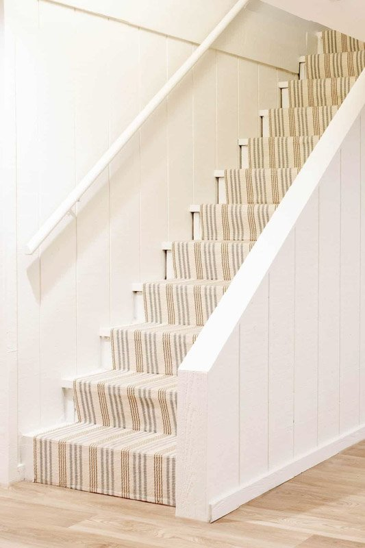 Patterned basement staircase painted off-white