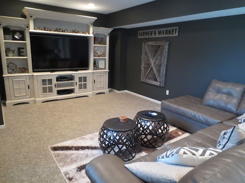 A renovated and furnished basement space featuring Urbane Bronze paint on the walls.