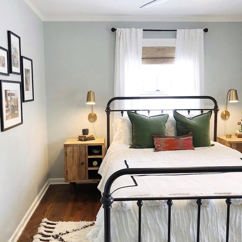 A small guest room with gray walls and black accents.