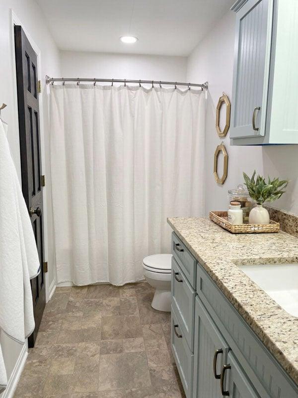 A bathroom vanity repainted using SW's Silver Strand.