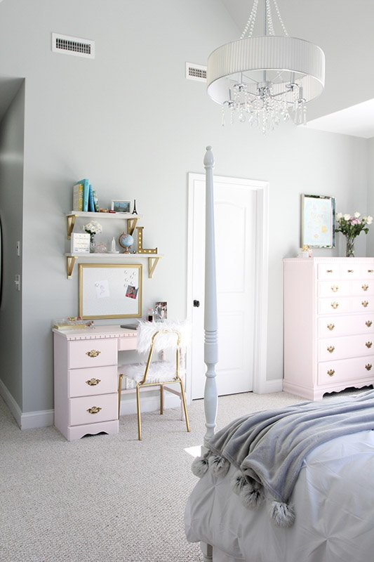 A girl's bedroom with pink painted desk and dresser, and silver blue wall paint.