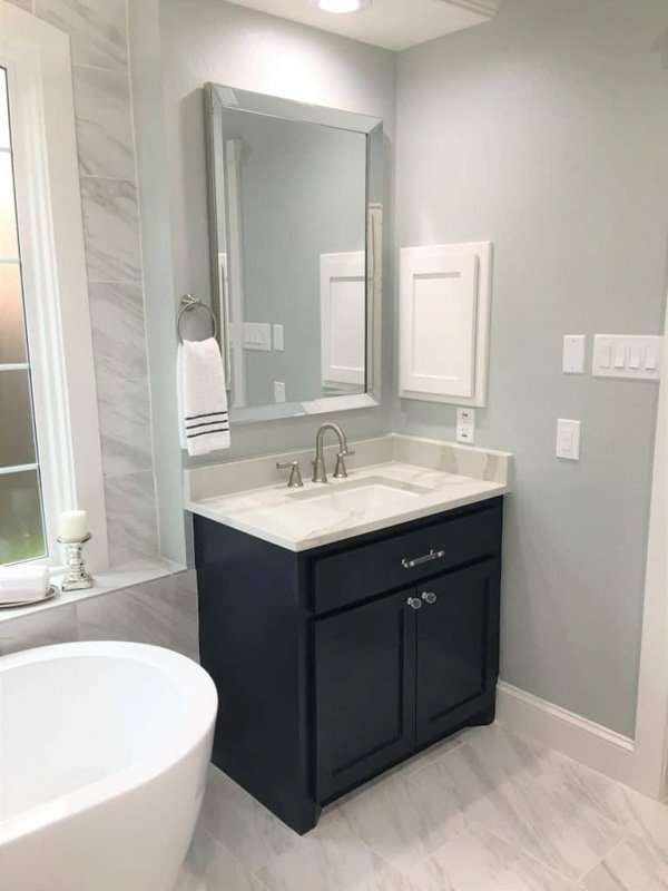 Sherwin Williams naval paint on a small vanity in a bathroom.