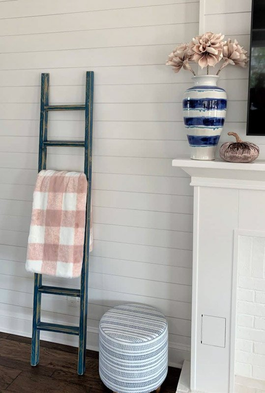 Sherwin Williams' Silver Strand on shiplap walls, with a blanket ladder leaning against.