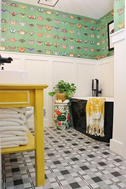 an eclectic bathroom with BM swiss coffee board and batten and yellow and green accents