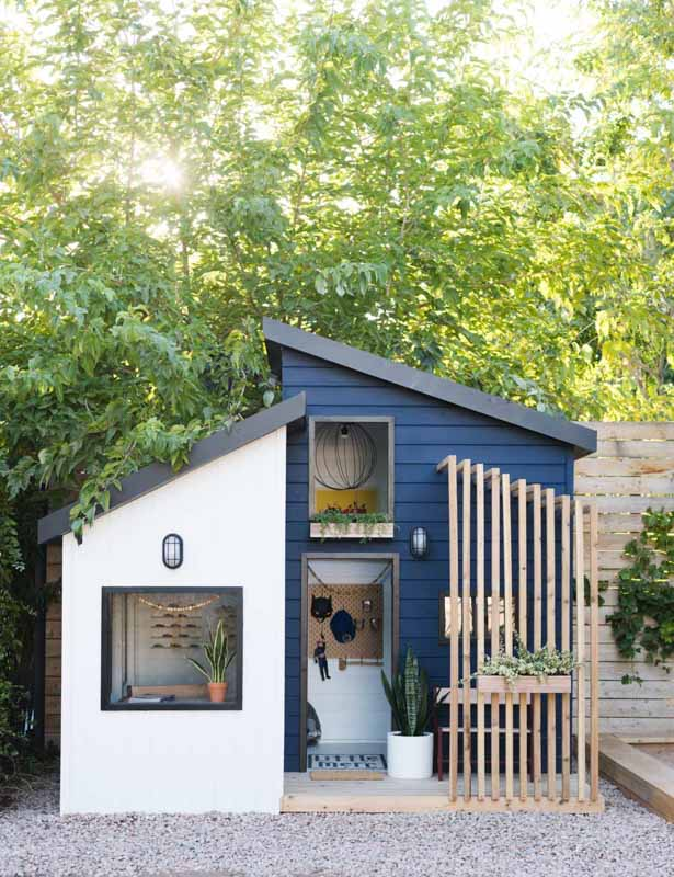 playhouse exterior in Sherwin Williams Naval blue and white paint