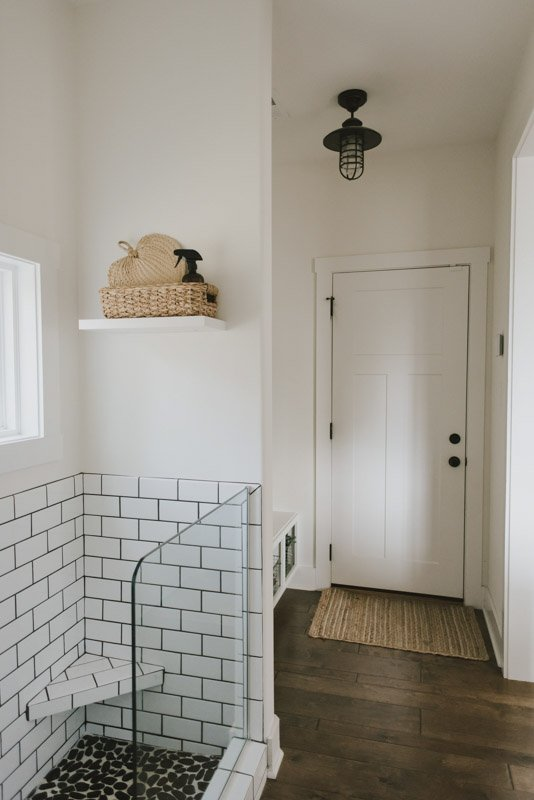 mudroom with white subway tiles painted Swiss Coffee