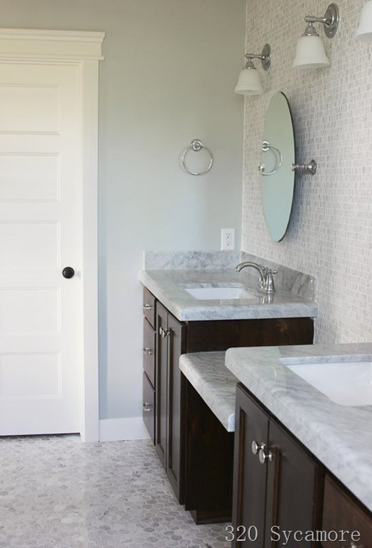 A bathroom with two vanities and sinks, with walls painted silver strand