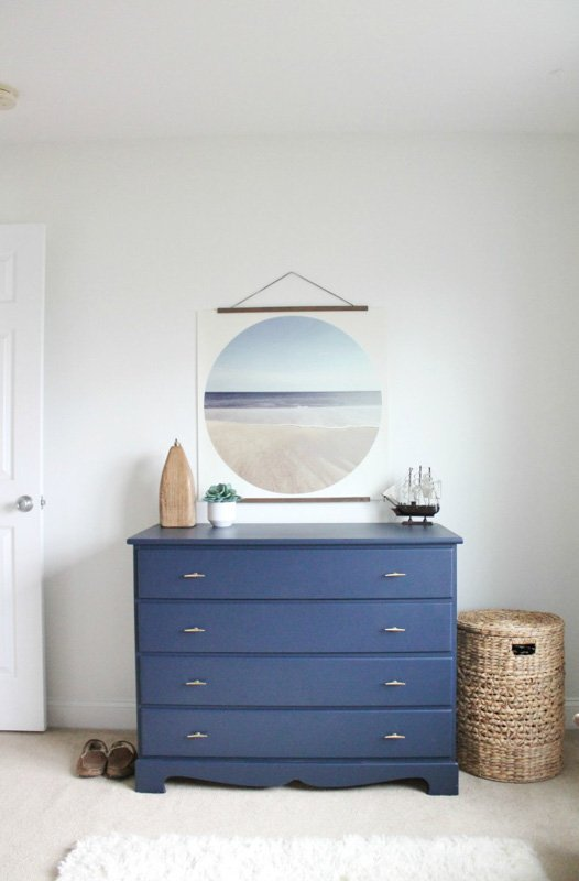 a small dresser painted in SW naval with casual decor
