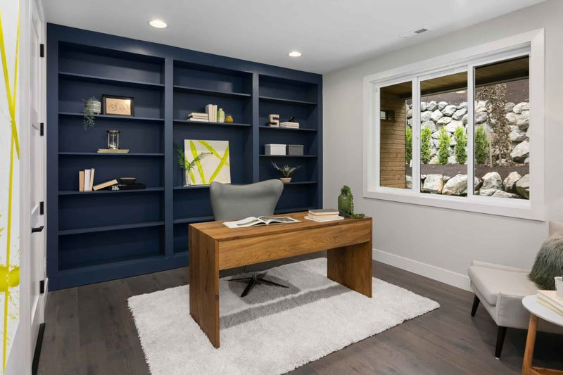 home office built in shelving in navy blue