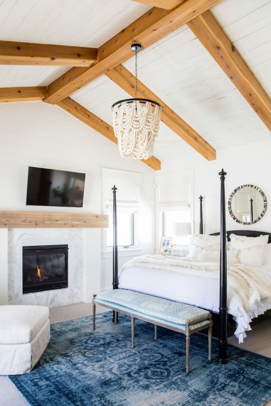 bedroom painted swiss coffee with vaulted ceilings and wooden beams