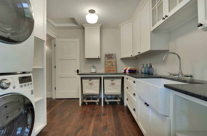 A very large laundry room painted SW City Loft