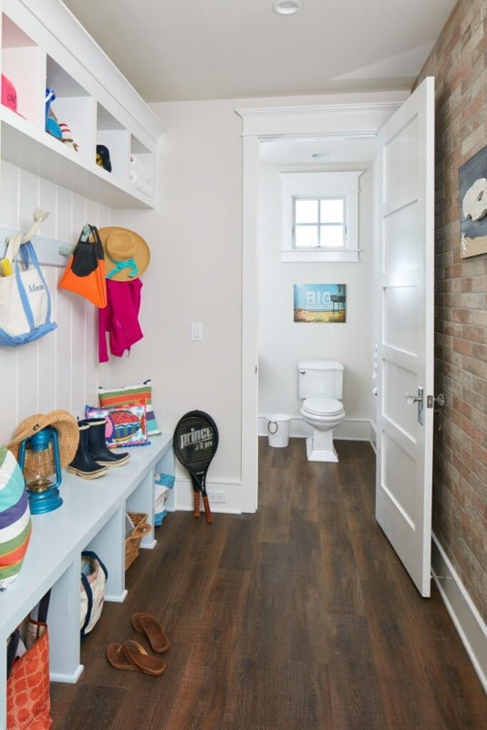 Sherwin Williams city loft painted mudroom with bench with cubbies full of shoes and bags