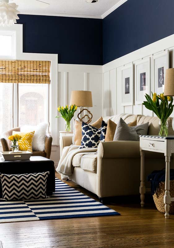 Upper wall and ceiling of a living room in dark navy Sherwin Williams paint.