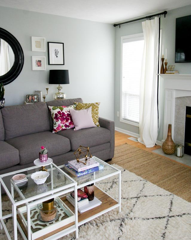 A small living space with a fireplace feature and silver strand painted walls.