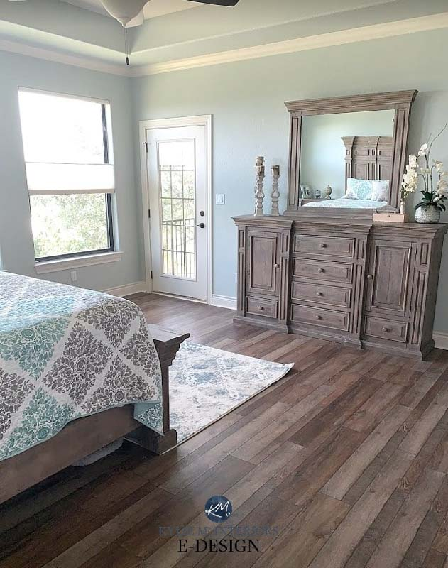 A fresh bedroom space with a light blue gray interior paint.