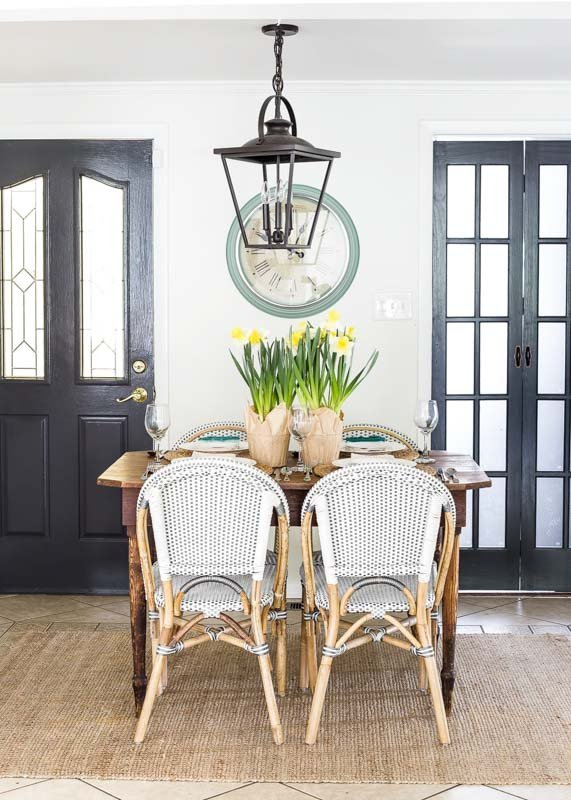 A BM swiss coffee dining space with 2 painted doors and light fixture painted black and