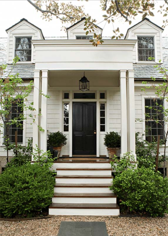 Exterior of a classic home with swiss coffee painted siding