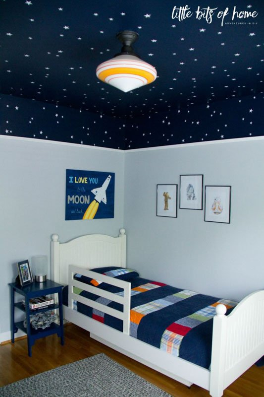 A boys bedroom painted gray and the ceiling in SW Naval, covered in stars.