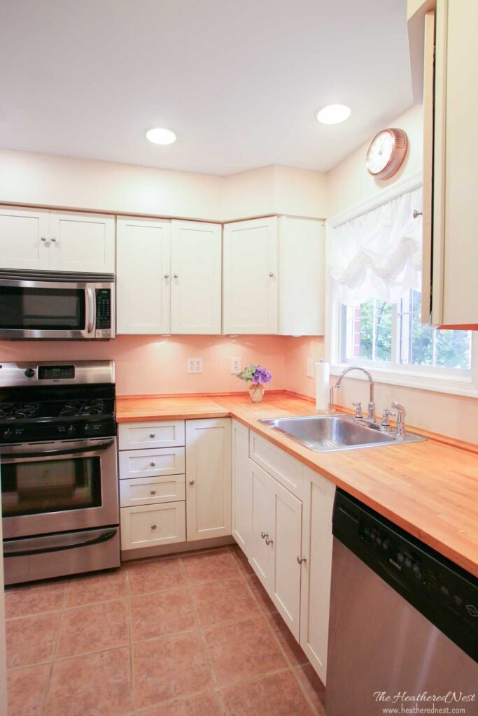 IKEA Karlby butcher block countertops in a historic townhome kitchen with stainless appliances and white cabinets
